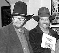 L. Neil Smith and Scott Bieser in 2009 after receiving the Prometheus Award for The Probability Broach: The Graphic Novel.